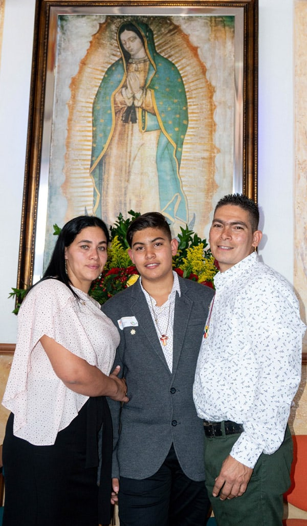 Family in front of Our Lady of Guadalupe