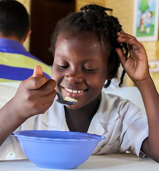 Girl eating at INSA school