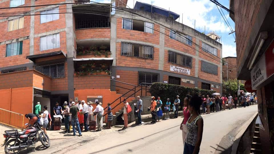 People waiting in line for food in Medellin, Colombia