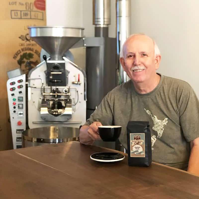 John Howard drinking coffee